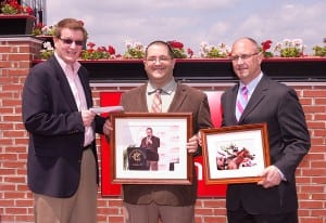 Maryland Jockey Club president Tom Chuckas (left) and Vice President-Communications Mike Gathagan (right) present Frank Carulli with parting gifts.  Photo by Jim McCue, Maryland Jockey Club.