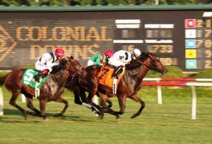 Forest Boyce, aboard Nellie Cashman, upset the Virginia Oaks in 2013.  Photo by Nick Hahn.