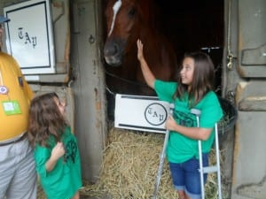 Ed Stanco's granddaughters, Bella (left) and Avery, and their favorite horse.