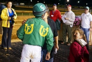 Gustavo Larrosa gets the winner's reward after piloting Lucy's Bob Boy in the Wild and Wonderful.  Photo by Vas.