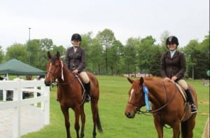 All in the family.  Emilie, left, and Kelsie Figgins have inherited their family's love of horses.  Photo courtesy of Ollie Figgins, III.