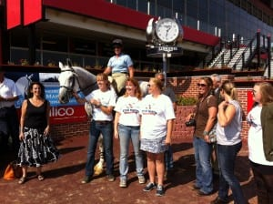 Stud Muffin, along with his people, hams it up in the Pimlico winner's circle.