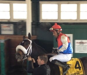 An exhausted Victor Santiago takes Behemoth back for the win photo following the Campbell.  Photo by The Racing Biz.