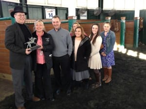 Maryland Racing Media Association president Ted Black (far left) presents the Maryland-based Horse of the Year trophy to owner Susan Wantz, trainer Ollie Figgins, III, and the Figgins family.  Photo by The Racing Biz.