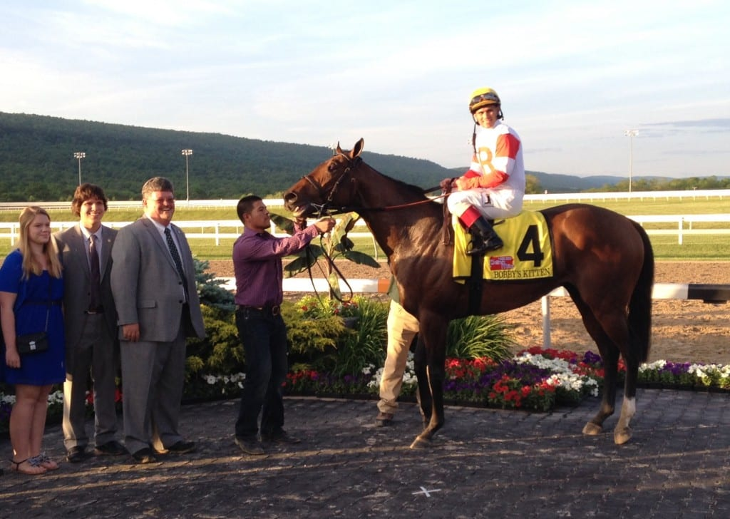 Stephanie, William, and Jeff Ramsey smile for victorious Bobby's Kitten after the Penn Mile. Photo by The Racing Biz.