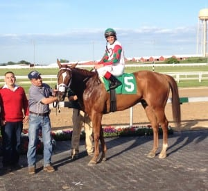 Winning his second Pennsylvania Governor's Cup was no sweat for Tightend Touchdown and assistant trainer Henry Argueta, in red.