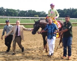 Mike Caruso (in tie) and Rudy Rodriguez (far left in ball cap) accompany Belle Gallantey after the Delaware Handicap. Jose Ortiz rode.  Photo by The Racing Biz.