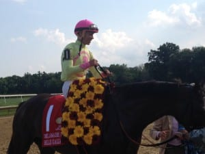 Jose Ortiz is all smiles after Belle Gallantey upset the Delaware Handicap. Photo by The Racing Biz.