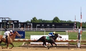 Picko's Pride wins, but then doesn't. Avarice (#2) was placed first after disqualification. Photo by The Racing Biz.