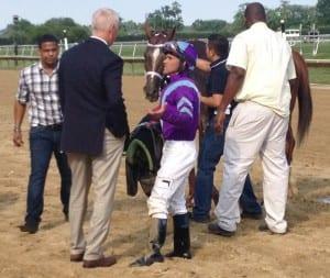 Jockey Javier Castellano and trainer Todd Pletcher (blue blazer) discuss Princess of Sylmar's defeat. Photo by The Racing Biz.