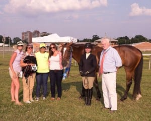 Sabrina Moore holds Totally Thoroughbred Horse Show champ My Fantastic Lady. Photo by Jim McCue, Maryland Jockey Club.