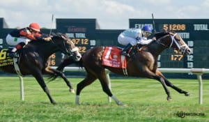 Divine Oath, with Jose Caraballo up, takes the Kent Stakes at Delaware Park. Photo by HoofprintsInc.com.