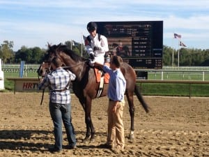 Jockey Forest Boyce and trainer Tres Abbott shake on Nellie Cashman's victory.