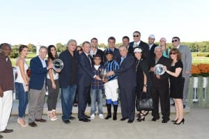 Vosburgh winner's circle. Freddie Velazquez is at right, holding silver plate along with wife Anita. Photo by NYRA.