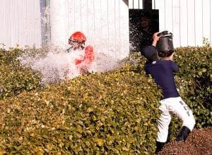 Darius Thorpe gets the traditional first-win bath. Photo by Jim McCue, Maryland Jockey Club.