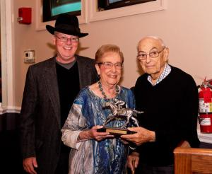 Harold Snyder (right) and wife Marcia smile after receiving his Finney Award from Maryland Racing Media Association president Ted Black. Photo by Ellen B. Pons.