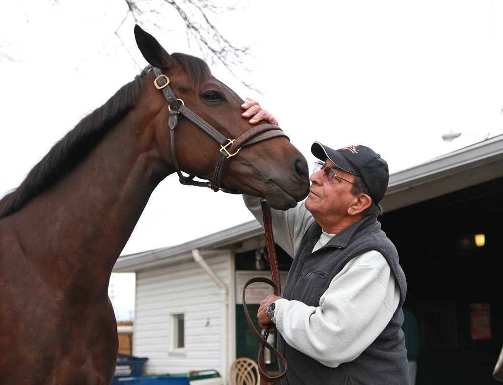 Trainer John Mazza gives a kiss to the nose of Stiffed, a 4-year-old New Jersey-bred filly, on April 13. Photo By Bill Denver/EQUI-PHOTO.