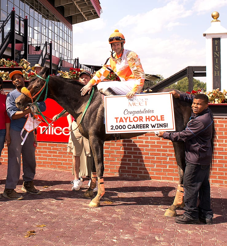 A pat for Dr. Bolt and win number 2,000 for Taylor Hole. Photo by Jim McCue, Maryland Jockey Club.