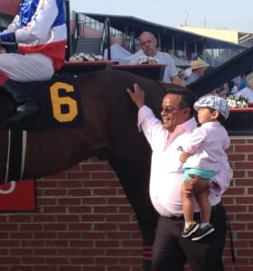 Jose Corrales and son Pachi enjoyed Bodhisattva's win in the Federico Tesio Stakes. Photo by The Racing Biz.