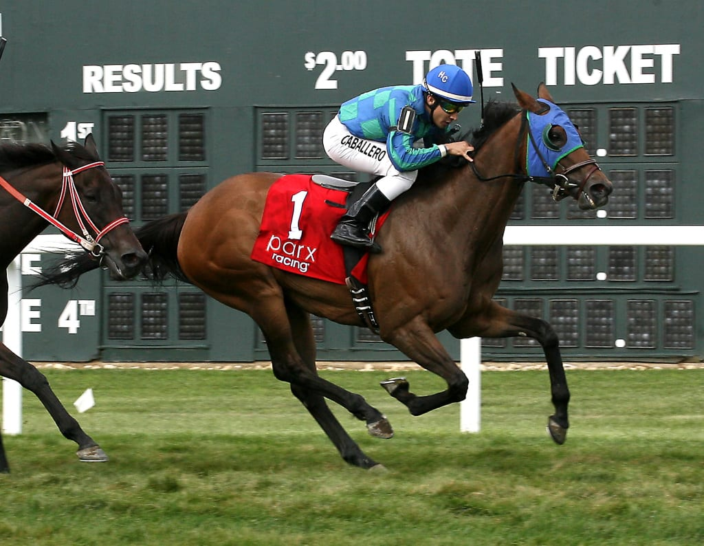 Kiss the Daddy rallied late to take the Power by Far at Parx Racing. Photo by Barbara Weidl/EQUI-PHOTO