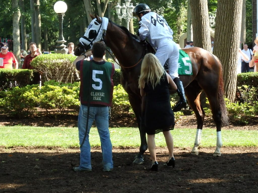 Kathy Ritvo gives son Michael a leg up on Fast Anna.