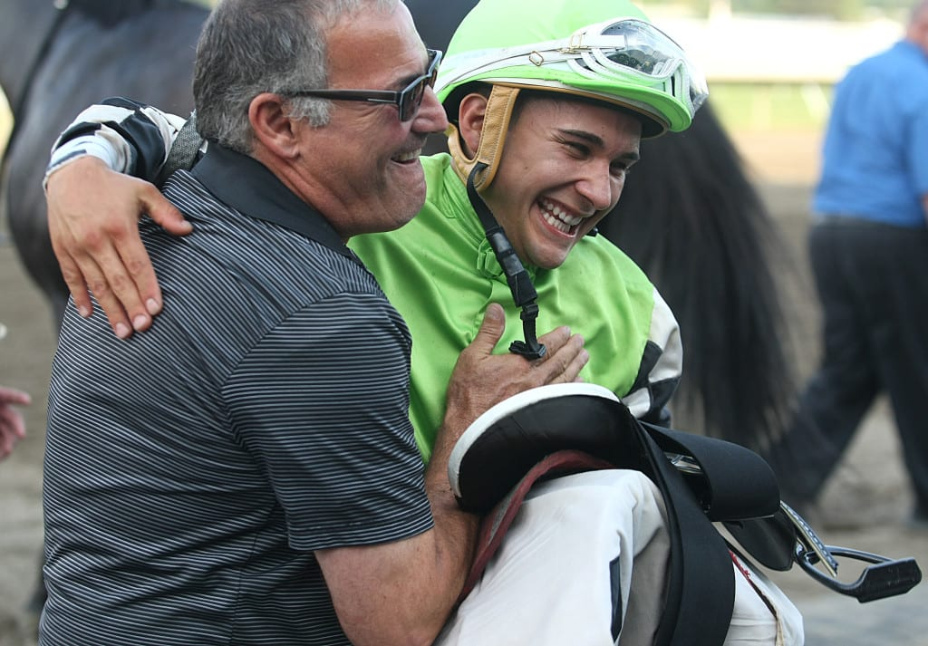 Trainer Marcus Vitali (L) and Jockey Nik Juarez celebrate after Juarez guided the Vitali trained Valid to victory in the $150,000 Philip H. Iselin Stakes. It was the first stakes win for Juarez. Photo By Bill Denver/EQUI-PHOTO