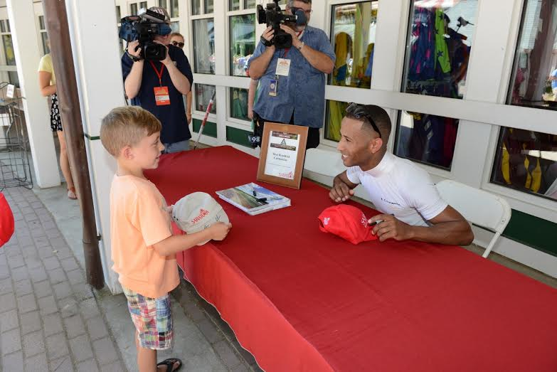 Kendrick Carmouche signs for the fans. Photo by NYRA/Adam Coglianese.