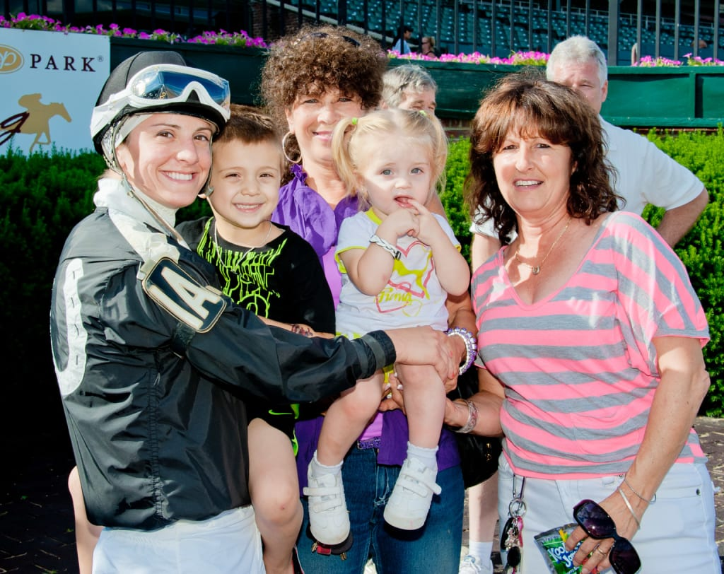 Maria Remedio with son Caleb, daughter Arabella, and mom Patti (at right) after a 2013 victory. Photo by HoofprintsInc.com