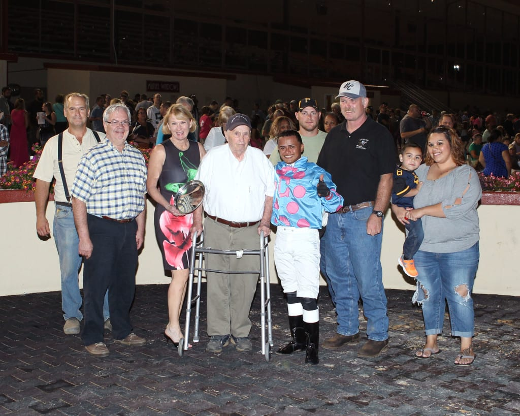 James Casey, center in white shirt, jockey Antonio Lopez, and the gang celebrate Greenway Court's win in the It's Only Money Stakes. Photo by Coady Photography.