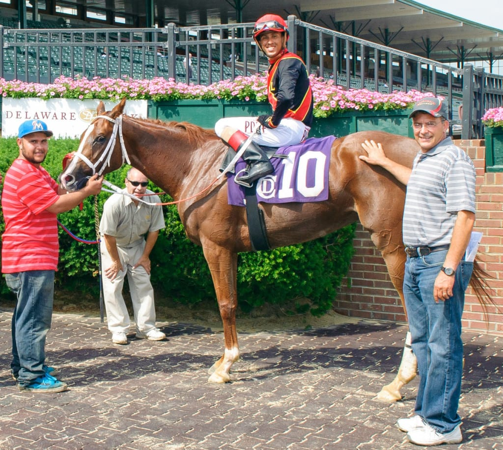 Gary Capuano, right, with Intrepid Alex winning at Delaware Park in June. Intrepid Alex is Delaware-certified. Photo by HoofprintsInc.com