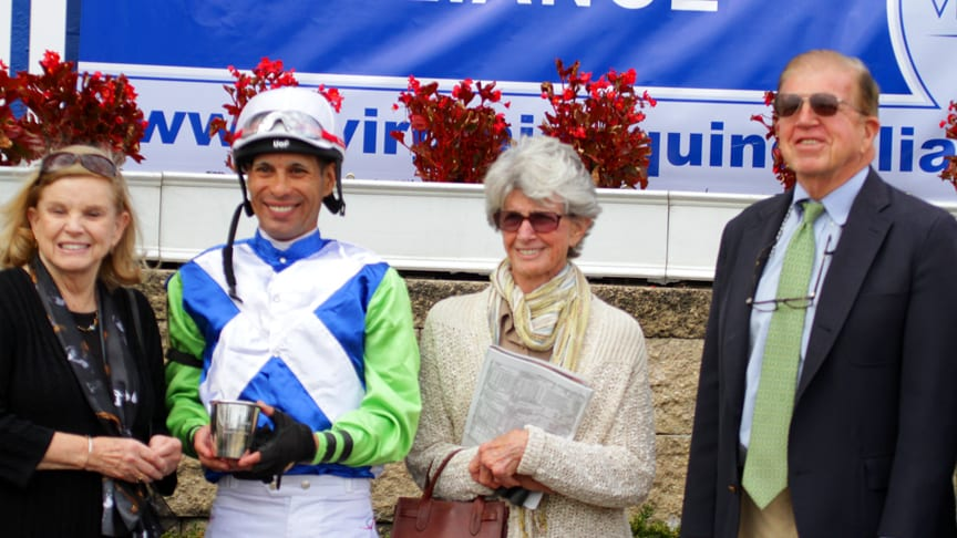Roy and Gretchen Jackson (far right, second from right), joined jockey Daniel Centeno in the winner's circle after Exaggerated won the Oakley. Photo by Laurie Asseo.