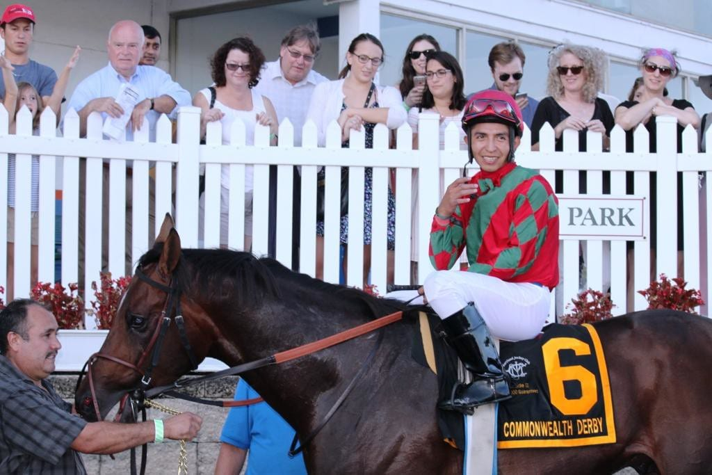 Ronald Hisby smiles for the cameras after winning the Commonwealth Derby. Photo by Nick Hahn.