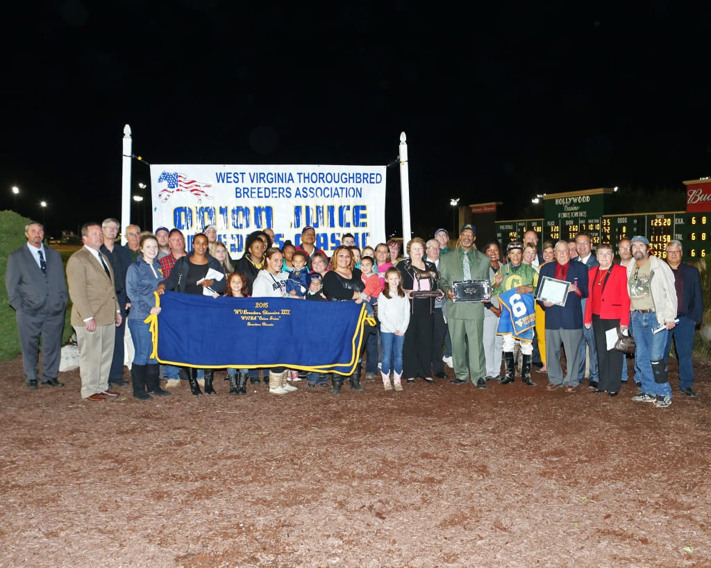 Big crowd celebrates Help a Brother's win in the Onion Juice. Trainer Lewis Craig, Jr. is in the front row, fifth from right, in green suit. Photo by Coady Photography.