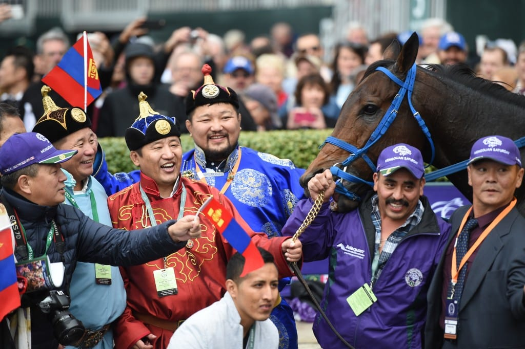 Smiles abounded from the members of Mongolian Stable after their Mongolian Saturday upset the Turf Sprint. Photo by © Breeders' Cup/Weasie Gaines 2015