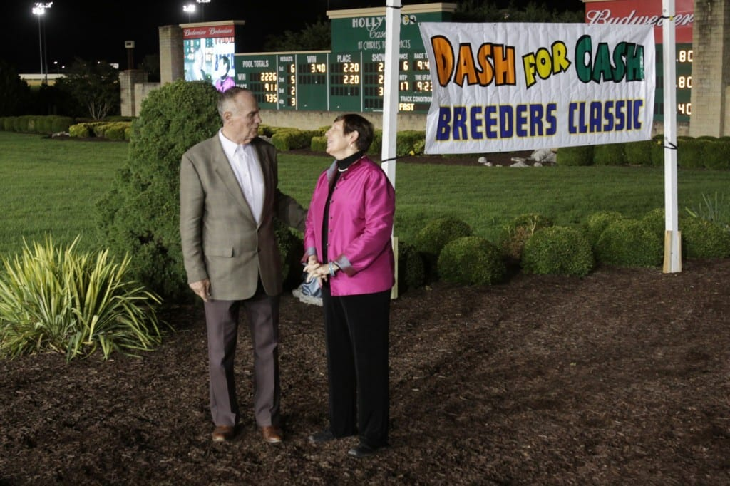 Trackside hosts and founders Sam Huff and Carol Holden share a moment at the 2015 West Virginia Breeders Classics. Photo by Coady Photography.