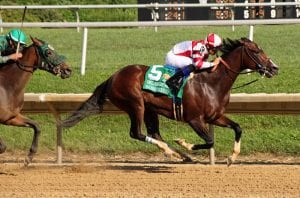 Songbird, tested, gives Porter first DelCap win