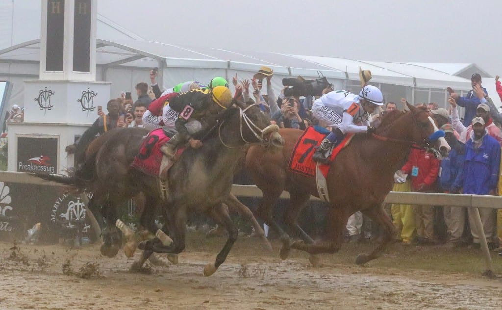 Justify prevails narrowly in foggy Preakness