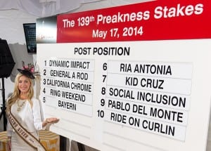 Ms. Racing Queen presents the post positions.  Photo by Jerry Dzierwinski, Maryland Jockey Club.
