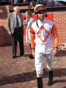 Julian Pimentel leaves the winner's circle after riding Ben's Cat to victory.  He'll ride Kid Cruz in the Preakness.  Photo by The Racing Biz.